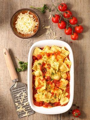 Gratin de ravioli ricotta épinard, crème de tomates et ganciale